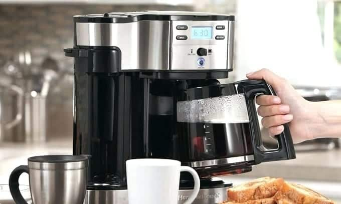 Taking Coffee From Coffee Grinder Brewer Combo