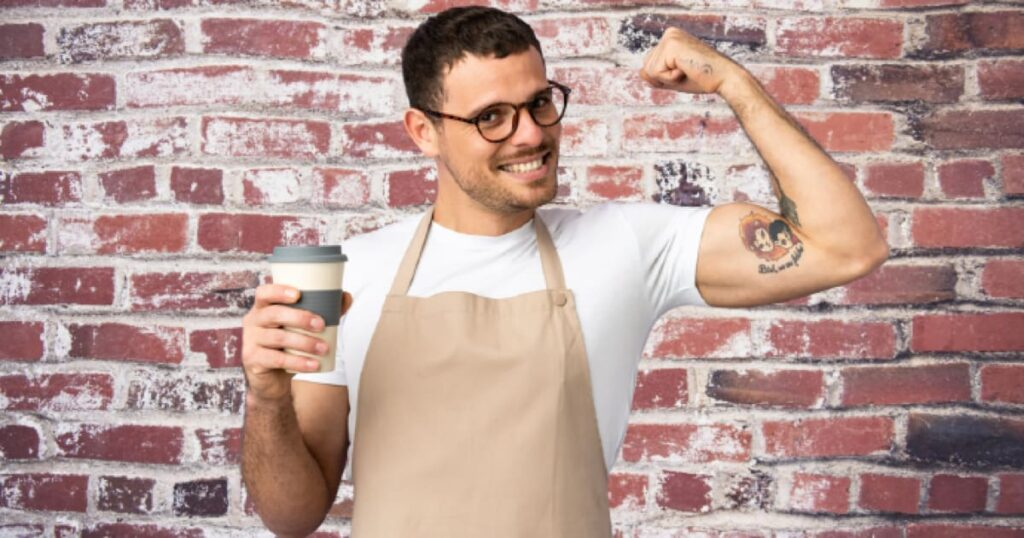 strong arm man holding coffee